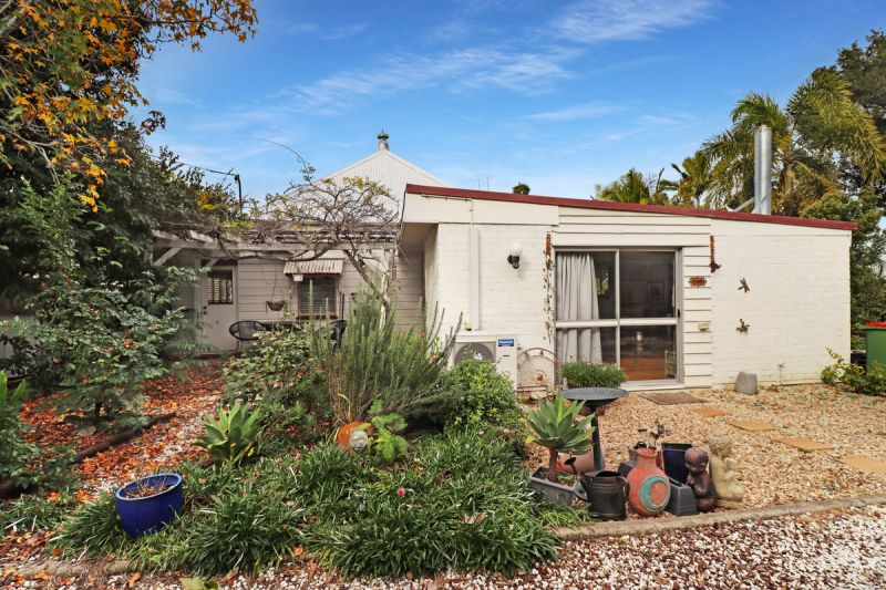 Quaint English style Home full of character + positioned in a prime location..