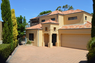 Tuscan style family home with 4 bedrooms and 3 bathrooms.