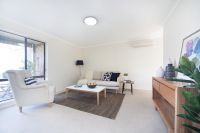 Refurbished retirement unit in quiet garden surrounds