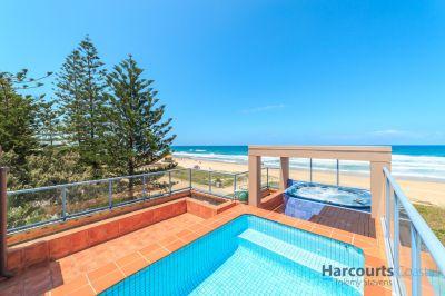 Absolute Beachfront Villa on prime north facing corner block