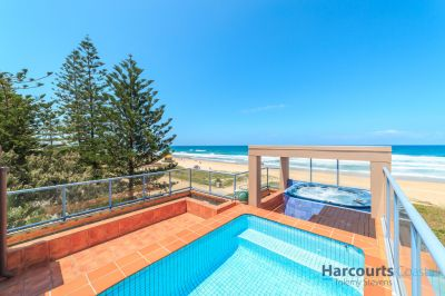 Absolute Beachfront Villa on prime north facing corner block