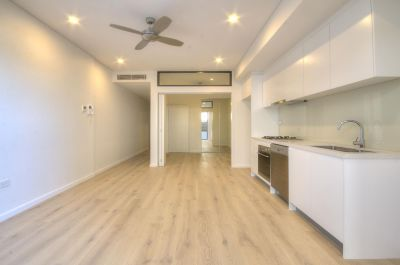 NEAR-NEW EXECUTIVE GARDEN APARTMENT IN THE VIBRANT HEART OF 'THE JUNCTION'