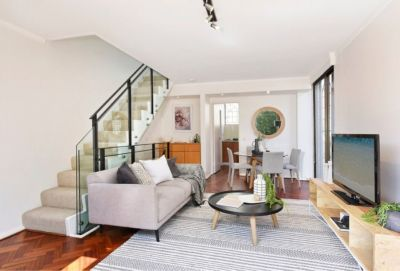 Stylish Terrace-Like Townhome in a Boutique Collection on the Edge of Centennial Park
