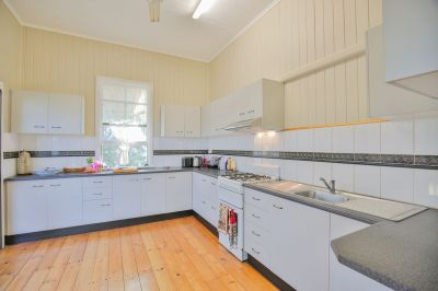 YOU BEAUTY! QUEENSLANDER WITH DUAL LIVING ON ¼ ACRE CLOSE TO EVERYTHING….