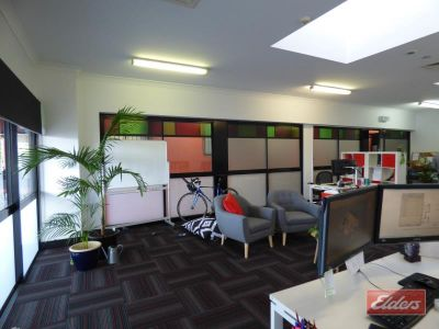 OPEN PLAN OFFICE WITH PRIVATE USE BALCONY!