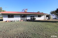 49.42 ACRES - BLOCK HOME - SHED - BORE
