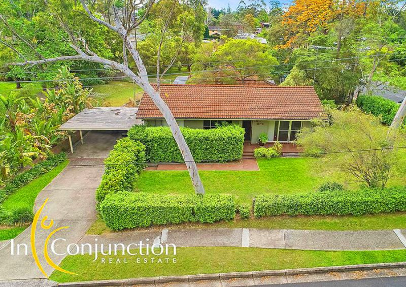 Perfect entry-level Attractive 3 bedroom single level home with pretty surrounding cottage gardens.