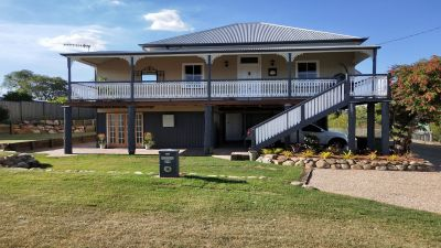Magnificent Queenslander Capturing the Essence of Luxury and Family Living