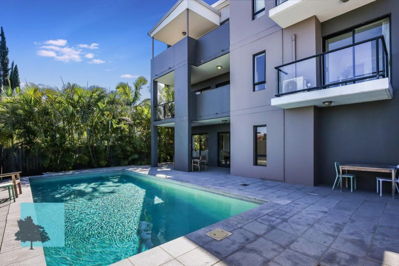 3.3 High Ceilings. Top level.  Located at the back of the complex!>