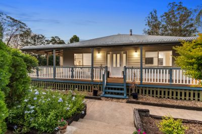 PRIVACY MEETS CONVENIENCE IN IDYLLIC LOCATION!