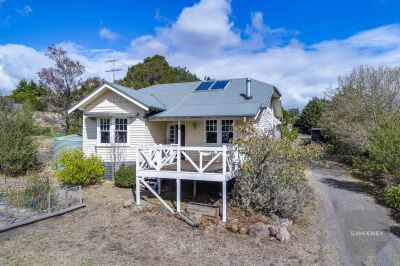 STYLISH WEATHERBOARD HOME WITH PICTURESQUE VIEWS
