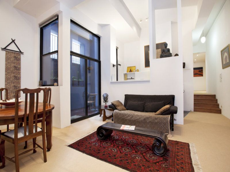 SPACIOUS INNER CITY APARTMENT WITH DIRECT ACCESS GARAGE AND TWO PRIVATE COURTYARDS