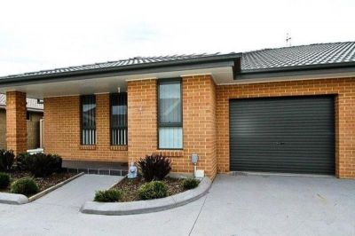 Immaculate Low Maintenance Living in Great Position