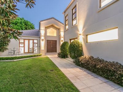 Elegant Family Residence of Enviable Privacy in sought after Hope Island Estate