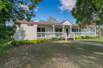 STUNNING HOME ON PICTURESQUE 20.9 ACRES IN COVETED LOCATION