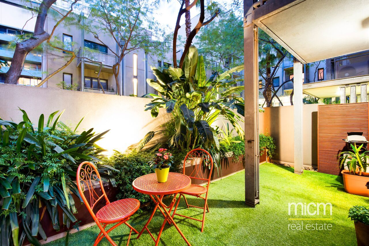 One of a Kind Furnished Apartment with Stunning 3-Sided Garden Oasis in Riverside Apartments!
