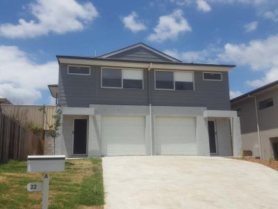 Easy To Maintain Townhouse in Prime Location