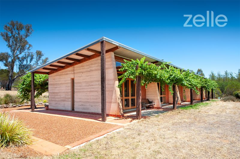 Eco-friendly Rammed Earth Style Gem with views to Table Top Mountain