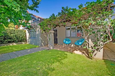 Delightful Freestanding Beachside Home Offers Sundrenched Level Gardens + Pool