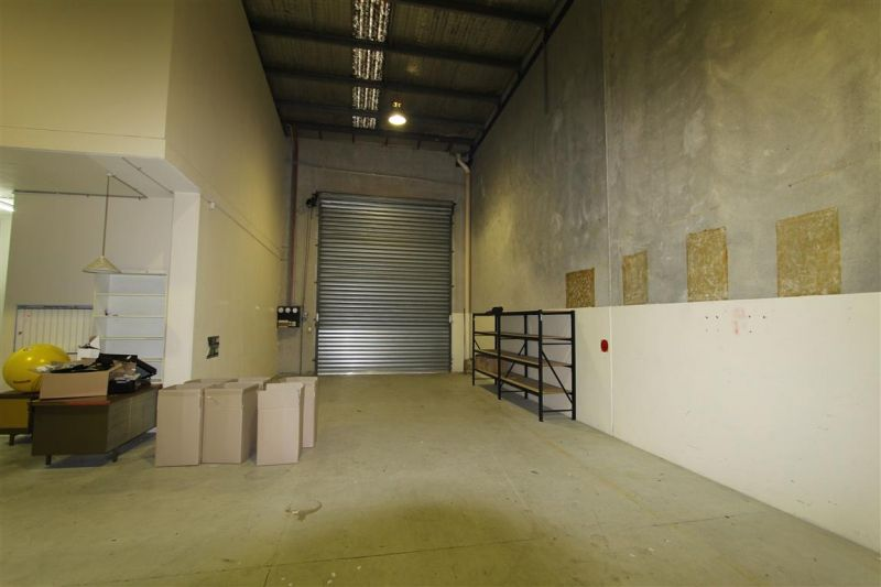 LEASED BY CARL PEARCE & RYAN MCMAHON - INDUSTRIAL UNIT