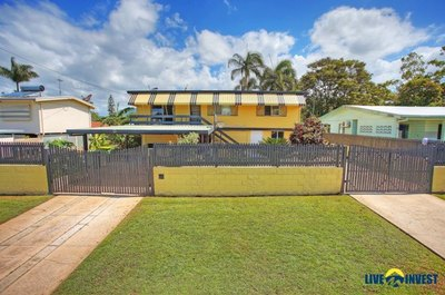 A TROPICAL OASIS SPACIOUS HIGHSET HOME –TWO SEPARATE LIVINGS AREAS- A SPARKLING IN-GROUND POOL & DUAL ACCESS DRIVEWAYS.