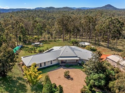 MASSIVE ARCHITECTURALLY DESIGNED HOME ON 5 PICTURESQUE ACRES