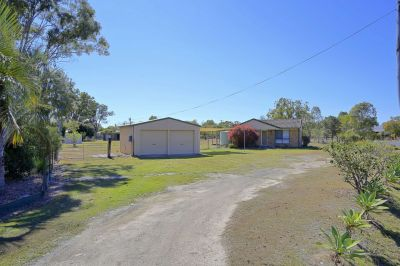 TIDY BRICK HOME ON 1 ACRE WITH TOWN WATER!