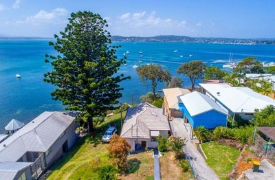 WATERFRONT Located on the Glistening Shores of Magnificent Lake Macquarie. Rare Opportunity of a Generation.