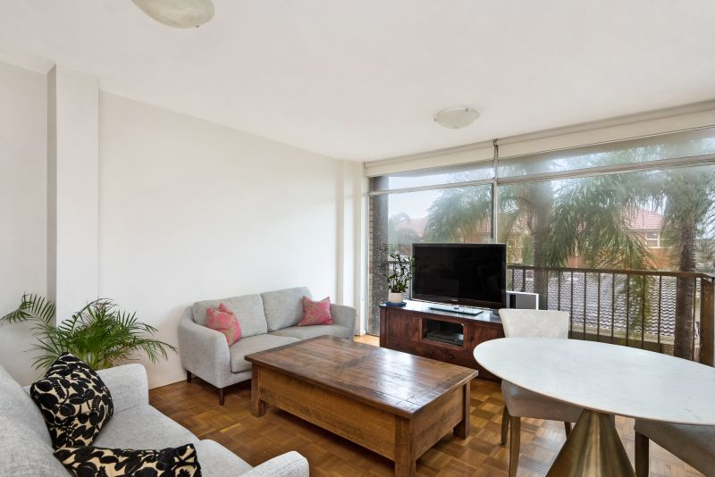 Spacious rear of block apartment in leafy surrounds