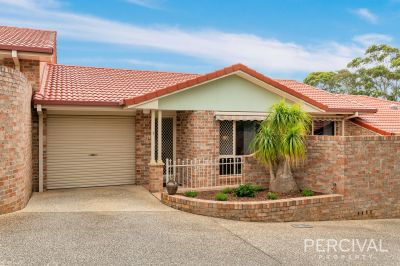 Attractive Level Living Villa...Enjoy This Close to Town Location!