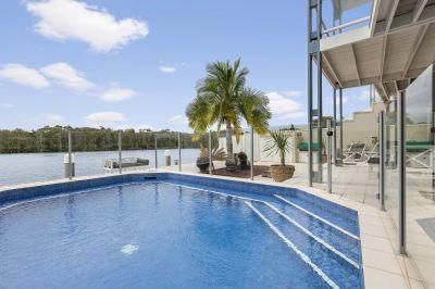 North Facing Riverfront Villa within a World Class Environment!