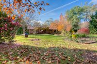 Large 5 bedroom Home on a Beautifully Established Acre of Land