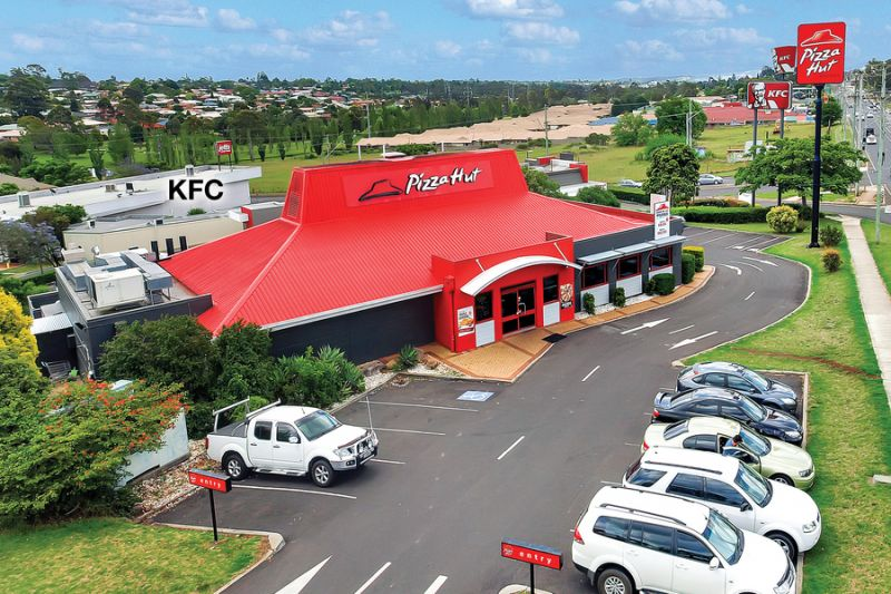 SOLD! Absolute Position Perfect Retail Corner - 10 Year Lease - Recent Major Building Upgrade
