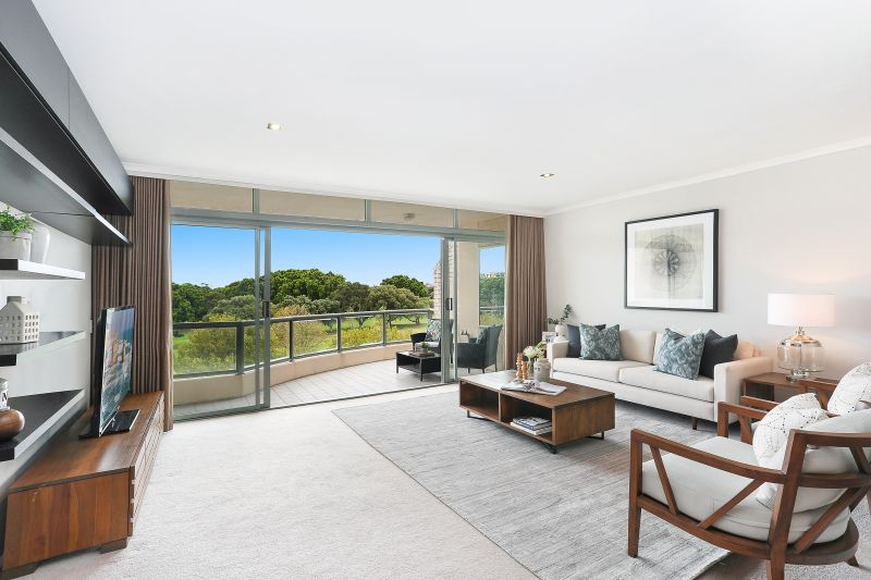 Prized top floor apartment with sweeping golf course and city skyline views in exclusive Raleigh Park Estate