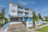 Modern Unit with Tenant in Place - Great Rental Returns!