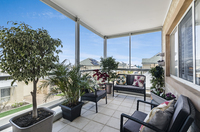 Light and bright three bedroom apartment offers ocean glimpses, vinyl wood flooring and plantation shutters.