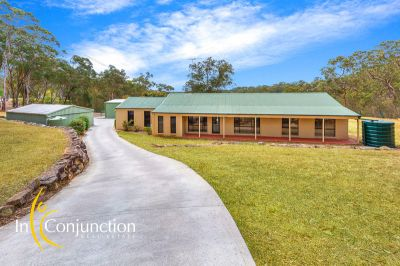 beautiful acreage with immaculately presented 4 bedroom single level home, large shed, in-ground pool and magical views.