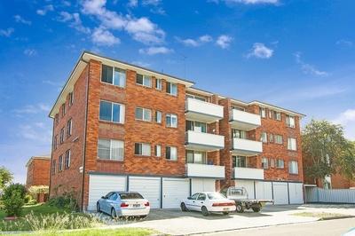 Updated Top Floor Apartment with Lock-up Garage