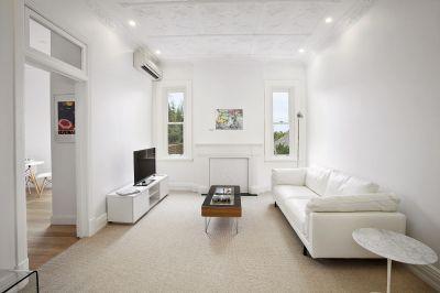 Idyllic Beachside Living in Huge Art Deco Top Floor Apartment With Parking