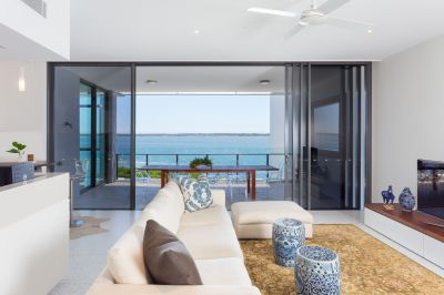 Stunning Broadwater Fronting Apartment with Optional Marina Berth