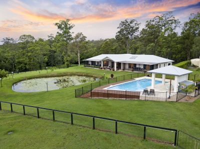 Modern Masterpiece with Usable Land, Self-Contained Studio & More