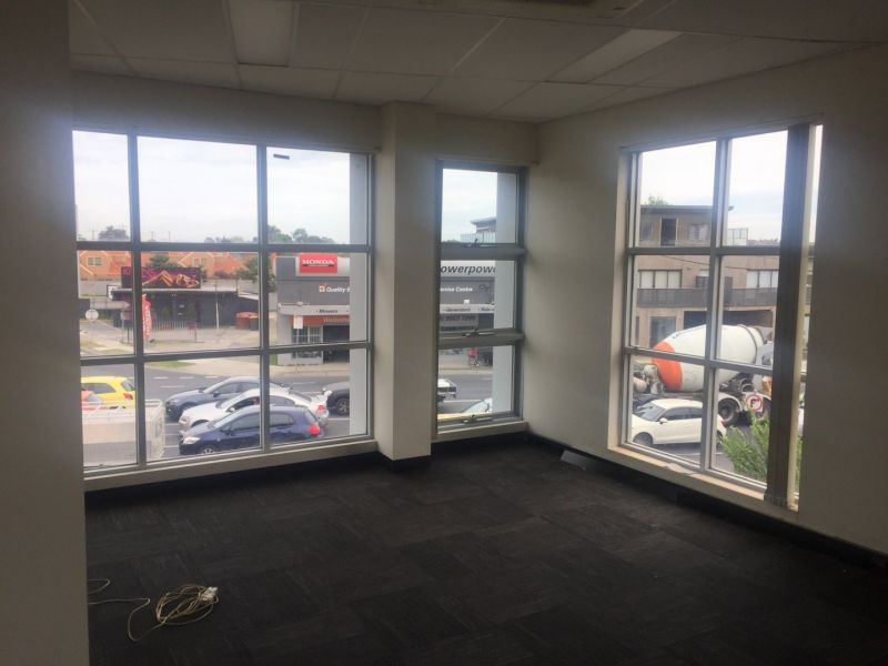 CORNER INVESTMENT OFFICE SUITE WITH GREAT EXPOSURE