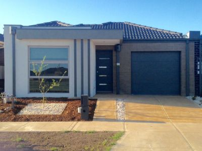 IMPRESSIVE BRAND NEW HOME OFFERS LOW MAINTENANCE  LIVING AT ITS BEST!