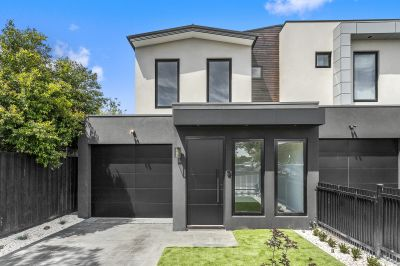 Architecturally designed townhouse situated in a highly sought after pocket