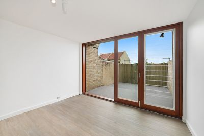 ULTRA MODERN SPLIT LEVEL WITH PARKING AND DISTRICT VIEWS