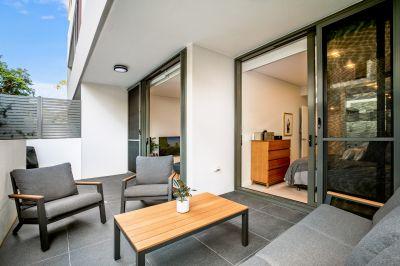 Designer ground-floor apartment footsteps from the village hub