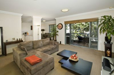 SPACIOUS APARTMENT WITH BALCONY AND RARE OVERSIZED DOUBLE GARAGE