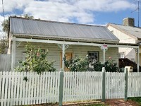 Cute cottage with the white picket fence