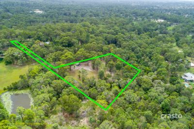 Exclusive & Private Acreage Paradise up for grabs!