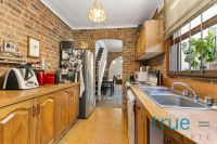 BEAUTIFULLY PRESENTED LOFT STYLE HOME IN HIGHLY SOUGHT AFTER LOCALE